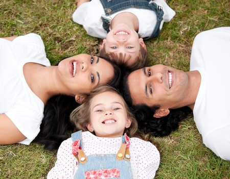 Positive family lying on the floor together Stock Photo - 10129114