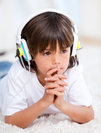 Pensive boy listenning music photo