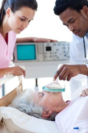 intensive care unit: Medical team resuscitating a senior patient Stock Photo