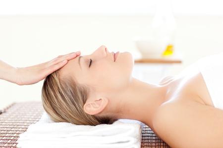 beauty center: Close-up of a relaxed woman receiving a head massage