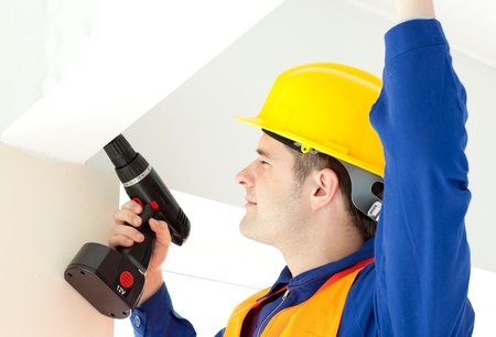 Busy electrician repairing a power plan photo