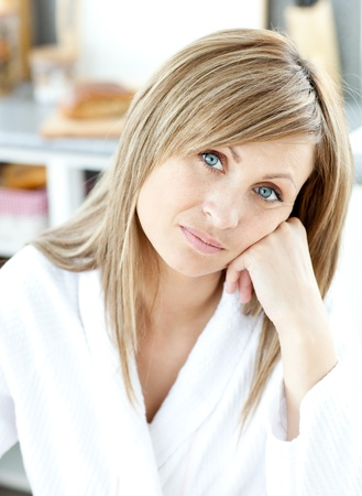 gratified: Teen woman looking at the camera in the kitchen Stock Photo