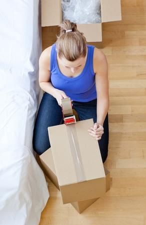 Beautiful woman closing a box  photo