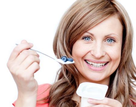 Happy woman eating a yogurt  photo