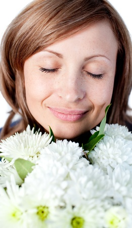 Portrait of a smiling woman holding a bunch of flowers photo