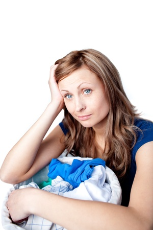 houseclean: Unhappy woman doing laundry