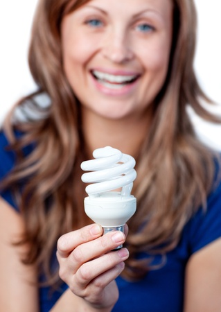 gratified: Radiant woman is holding a lightbulb  Stock Photo