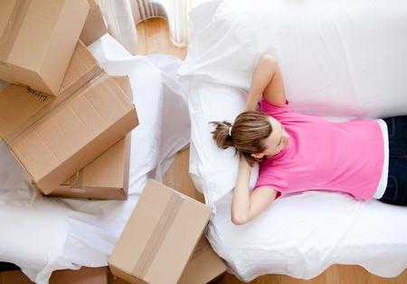 gratified: Caucasian woman relaxing between boxes