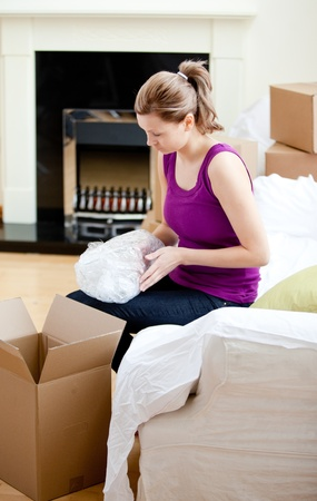 gratified: Caucasian woman having a break between boxes Stock Photo