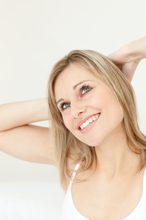 Happy woman stretching on her bed Stock Photo - 10114619