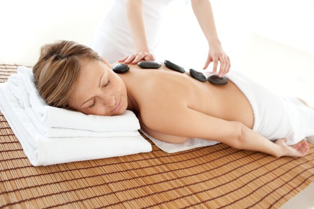 Delighted woman lying on a massage table photo