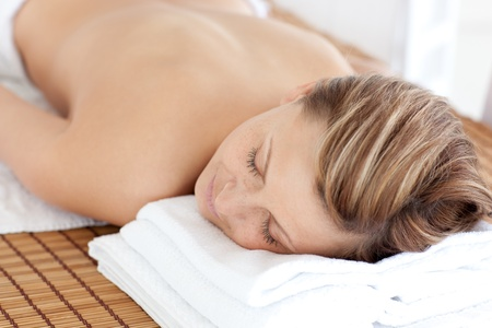 Portrait of a young woman having a massage with stones Stock Photo - 10115139