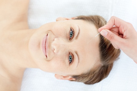Portrait of a cheerful woman in acupuncture therapy  photo