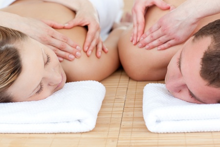 Young couple receiving a back massage  photo