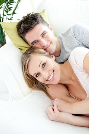 Beautiful lovers having fun together on a sofa photo