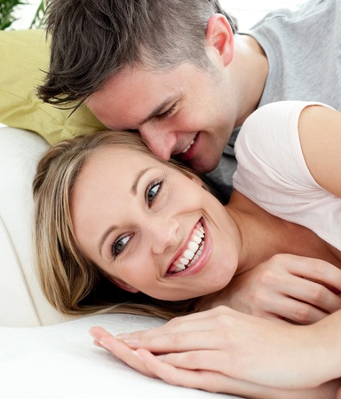convivial: United lovers having fun together on a sofa