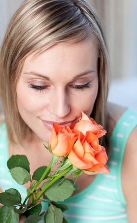 Charming woman smelling roses  photo
