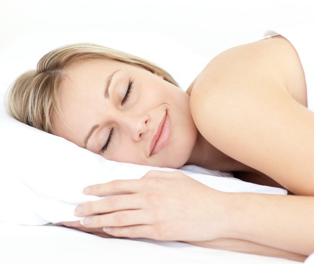 Radiant woman sleeping on her bed  photo