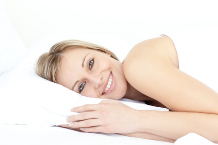 white pillow: Bright woman relaxing on her bed