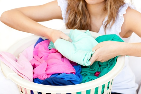 houseclean: Close-up of a woman doing laundry