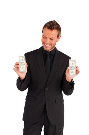 Smiling handsome businessman looking at dollars photo