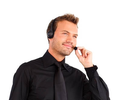 Businessman working with a headset on  photo