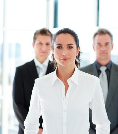 Confident businesswoman leading her team photo