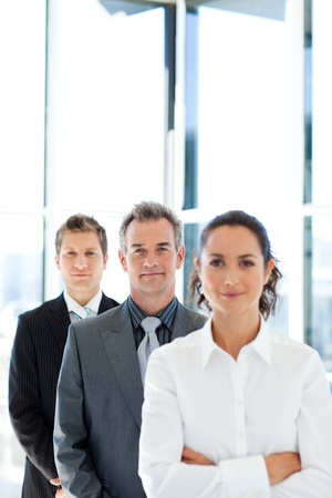 Matureusinessman in a line with his business team photo