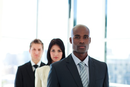 Serious African businessman leading his team Stock Photo - 10113399