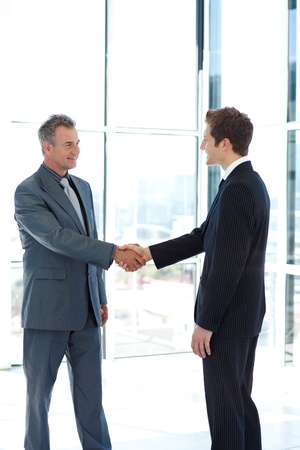 two companies: Businessmen shaking hands