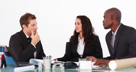 conversing: Businessteam conversing about a new plan Stock Photo