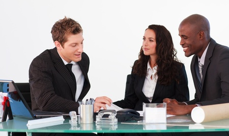 Three business people interacting in a meeting Stock Photo - 10114204