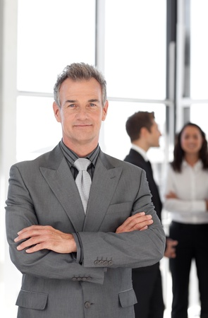 Senior Businessman with team in Background photo