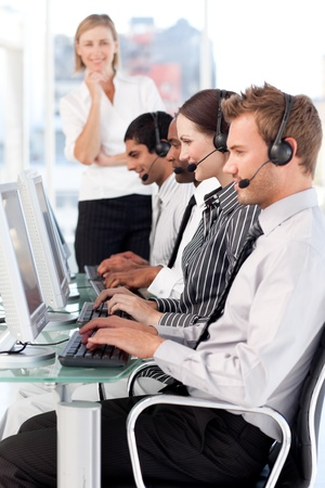 Delighted female leader managingher team in a call center photo