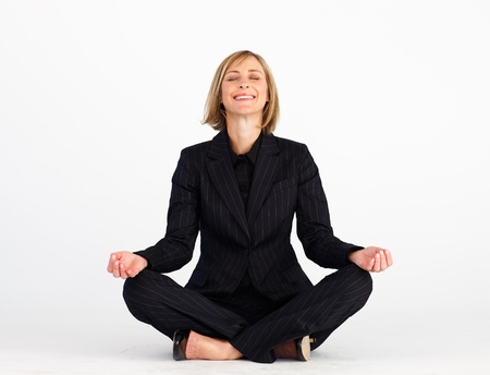 Mature businesswoman doing meditation exercises photo