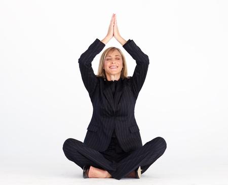 Businesswoman doing relaxation exercises  photo