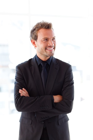 arms up: Smiling young businessman with folded arms Stock Photo