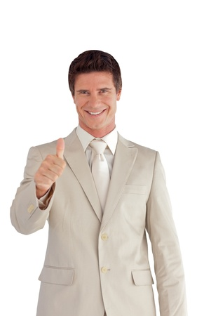 Positive businessman with a thumb up photo