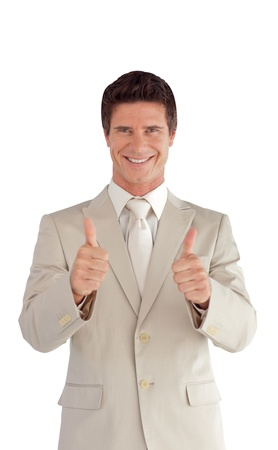 Successful businessman with thumbs up  photo