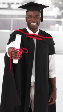 black graduate: Man smilling at graduation