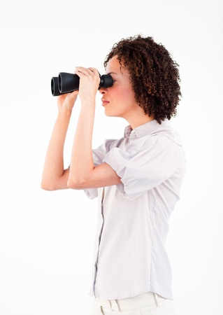 Sideways close-up of Afro-American businesswoman with binoculars  photo