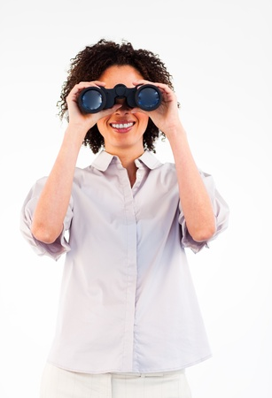 Smiling businesswoman looking through binoculars Stock Photo - 10113420