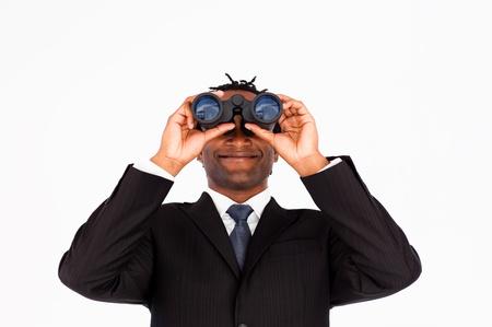 Businessman with binoculars  photo