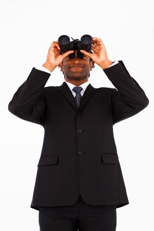 Friendly well-dressed businessman with binoculars  photo
