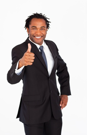 Handsome businessman with thumb up photo