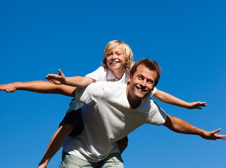 Young man giving young boy piggyback ride  photo