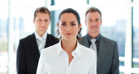 Beautiful businesswoman in front of her team photo