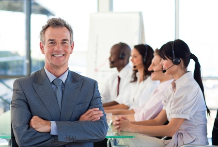 Business people working in a call centre Stock Photo - 10113880