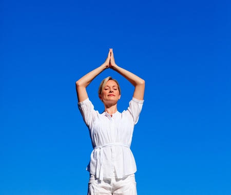 Attractive woman practising meditation photo