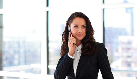 Young businesswoman talking on phone photo